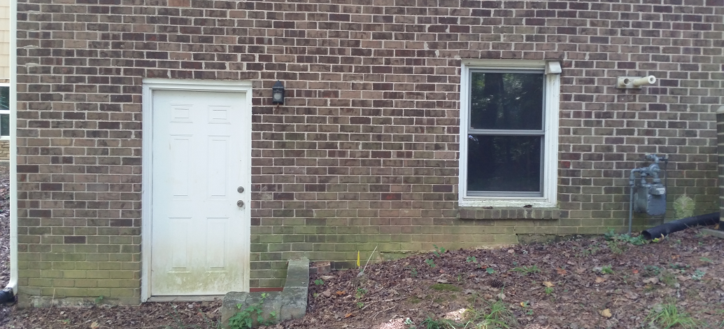 Brick mildew stains on a house in Atlanta, Ga. Recommend a professional house wash.