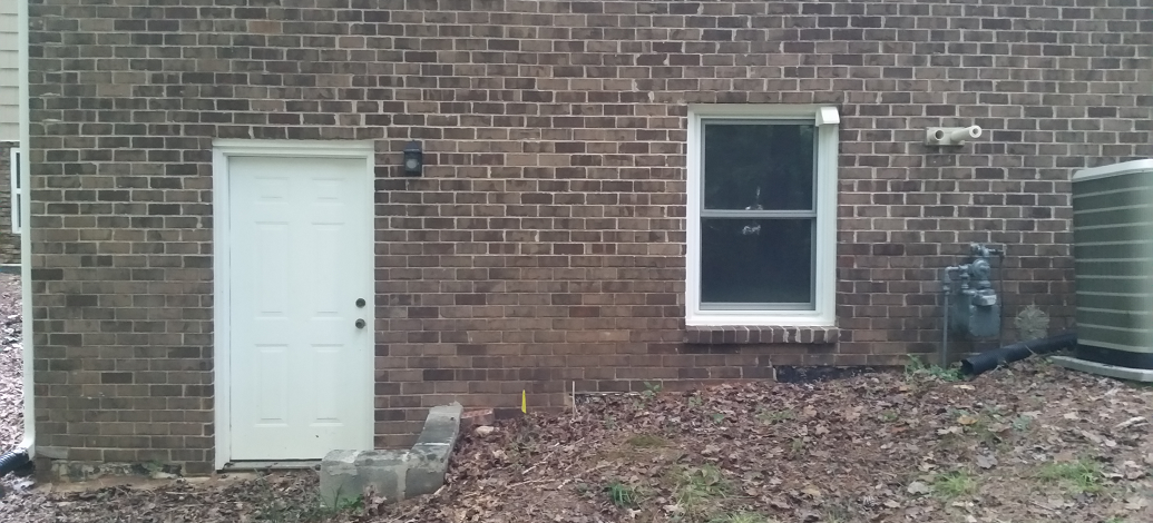 Professional house washing in Atlanta, Ga to remove mildew with brick pressure cleaning.