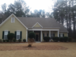 Freshly cleaned shingle roof to remove black streaks on a home in Peachtree City, Ga