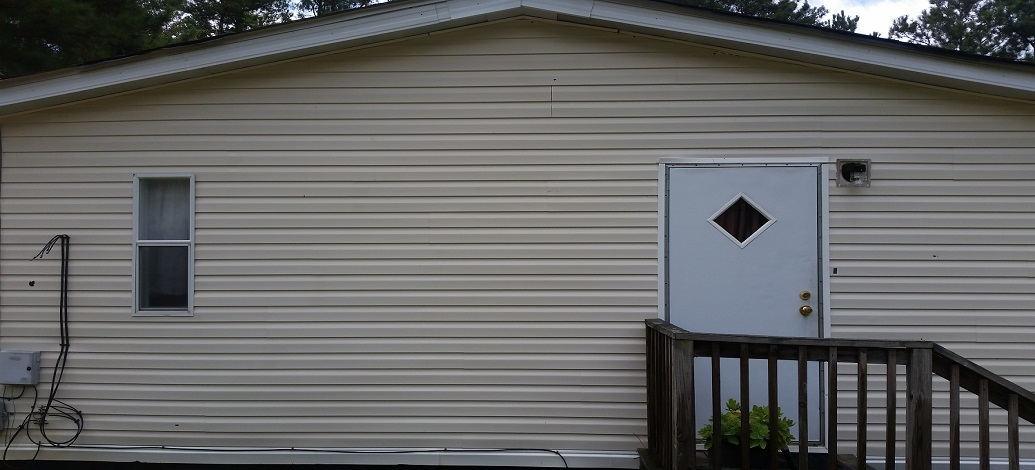 Safe, low-pressure, vinyl house washing in Manchester, Ga to remove mildew and bacteria.