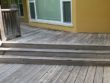 Wood deck grey fibers in need of pressure washing and staining in Newnan, Ga