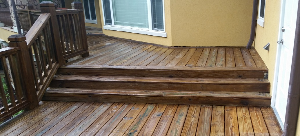 Cleaned deck in Newan, Ga that has been pressure washed to remove grey fibers. Stain has not been applied