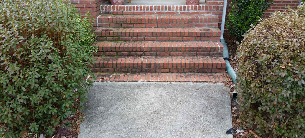 Pressure washing the front steps of a home in Fayetteville, Ga