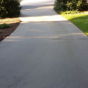 Pressure washing services in Peachtree City, Ga to remove black stains on concrete driveway.