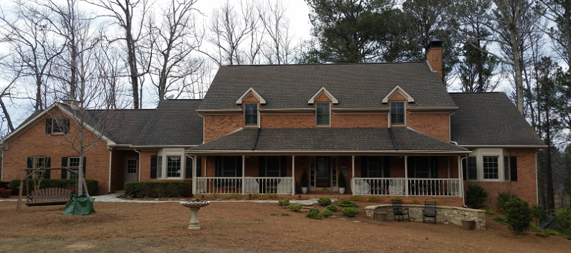 Roof Cleaning in Alpharetta, Ga. Black stains and streaks were removed with low pressure asphalt shingle cleaning.