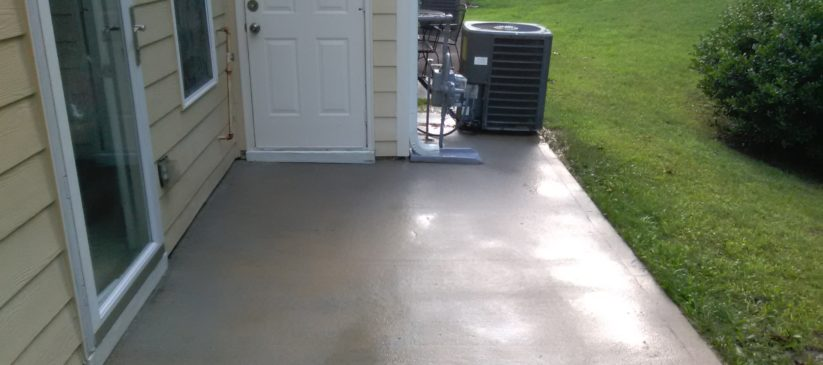 Tyrone pressure washing services to remove black stains and mildew from a patio.