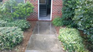 Commercial pressure washing demo to remove black algae from a sidewalk of an apartment complex in Atlanta, Ga