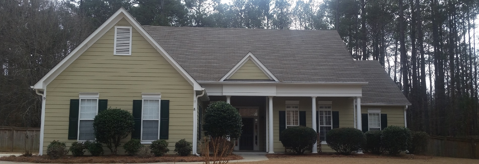 This home received a full makeover with pressure washing, roof cleaning, and house washing.
