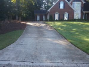 Newnan driveway with bacteria before power washing